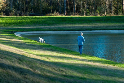 While local resident Fred Huntsinger fishes, his dog Dottie takes a water break.