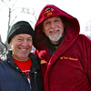 Harley Feldman and Bill Wenmark take a break from ice prep activities to pose for a photo.