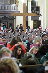 All pray during  Eucharistic Aderation at St. Paul Church during the CYM Cross Pilgrimage through the streets of Wilmington stopping at five churches, Saturday, March 23, 2012. www.DonBlakePhotography.com