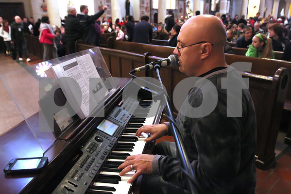 Musical guest John Angotti plays piano and sings at St. Anthony of Padua Church during the CYM Cross Pilgrimage through the streets of Wilmington stopping at five churches, Saturday, March 23, 2012. www.DonBlakePhotography.com