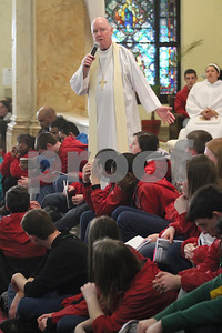 Bishop Malooly speaks before Eucharistic Aderation at St. Paul Church during the CYM Cross Pilgrimage through the streets of Wilmington stopping at five churches, Saturday, March 23, 2012. www.DonBlakePhotography.com