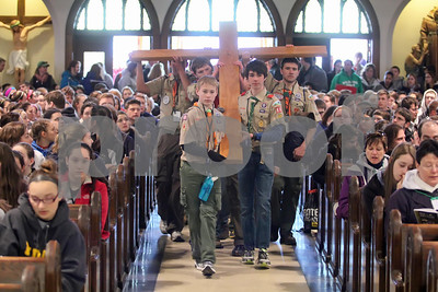 Boy Scouts carry the cross into St. Thomas the Apostle Church during the start of the CYM Cross Pilgrimage through the streets of Wilmington stopping at five churches, Saturday, March 23, 2012. www.DonBlakePhotography.com