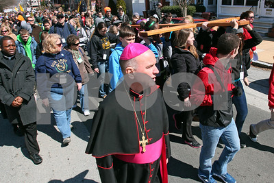 Bishop Malooly walks with the cross dring the CYM Cross Pilgrimage through the streets of Wilmington stopping at five churches, Saturday, March 23, 2012. www.DonBlakePhotography.com
