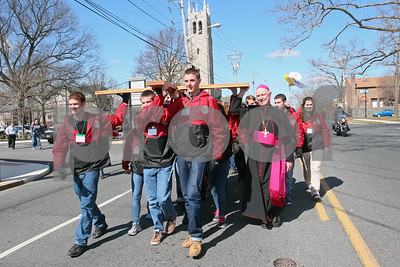 CYM youth leaders carry the cross from St. Thomas the Apostle Church during the start of the CYM Cross Pilgrimage through the streets of Wilmington stopping at five churches, Saturday, March 23, 2012. www.DonBlakePhotography.com