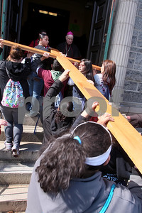 Members of St. Paul Parish carry the cross into St. Paul Church during the CYM Cross Pilgrimage through the streets of Wilmington stopping at five churches, Saturday, March 23, 2012. www.DonBlakePhotography.com