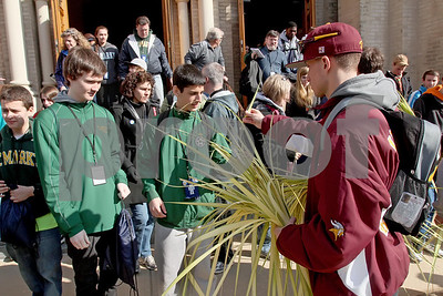 Plams are handed out at St. Hedwig Church during the CYM Cross Pilgrimage through the streets of Wilmington stopping at five churches, Saturday, March 23, 2012. www.DonBlakePhotography.com