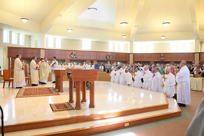 The candidates kneel before Bishop Malooly during their Ordination to the Diaconate at St. Margaret of Scotland Church, August 24, 2013. wwwDonBlakePhotography.com