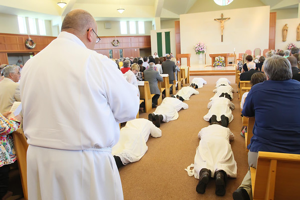 The candidates prostrate themselves during their Ordination to the Diaconate at St. Margaret of Scotland Church, August 24, 2013. wwwDonBlakePhotography.com