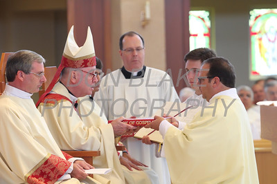 Candidate Mark Fontana recieves the Book of Gospels from Bishop Malooly during his Ordination to the Diaconate at St. Margaret of Scotland Church, August 24, 2013. wwwDonBlakePhotography.com