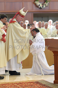 Candidate James Mueller kneels before Bishop Malooly for the Laying on of Hands during his Ordination to the Diaconate at St. Margaret of Scotland Church, August 24, 2013. wwwDonBlakePhotography.com