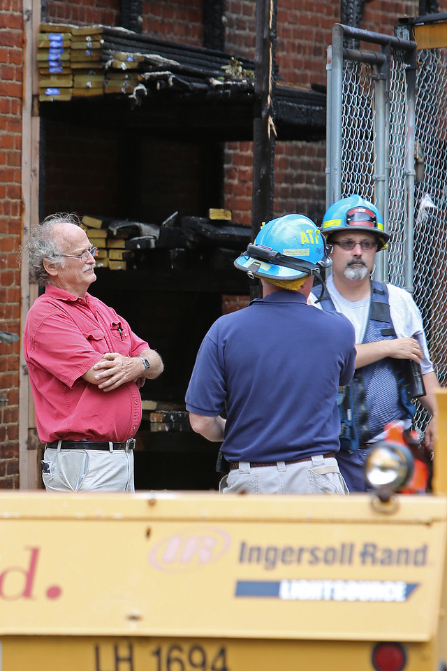 Frager's Hardware fire - the afternoon after, Capitol Hill, Washington, DC. June 6, 2013. Left: Owner, John Weintraub.