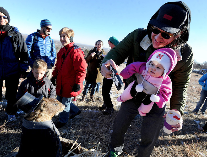 "Luke Trautwein and his daughter, Olive, 9-months, take a photo of Flatiron Freddy on Saturday at Chautauqua Park.The City of Boulder Park Rangers introduced about 75 people to the marmot who popped up to see his shadow.<br /> For more photos and a video, got to  <a href=""http://www.dailycamera.com"">http://www.dailycamera.com</a>.<br />  Cliff Grassmick  / February 2, 2013"