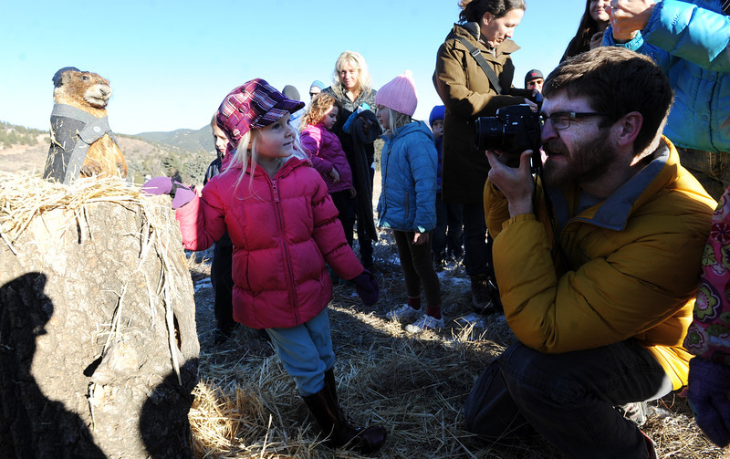"Matt Collins, right, takes a photo of his daughter, Sophie, 5, with Flairon Freddy on Saturday at Chautauqua Park.<br /> For more photos and a video, got to  <a href=""http://www.dailycamera.com"">http://www.dailycamera.com</a>.<br />  Cliff Grassmick  / February 2, 2013"