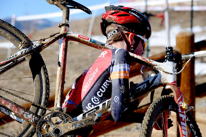 "Racer Eric Brunner, 14,  runs up the stairs with his bike during the ""A"" race of the 2012 New Years CX Race at Valmont Bike Park in Boulder on Saturday.<br /> For more photos and a video from the race, go to  <a href=""http://www.dailycamera.com"">http://www.dailycamera.com</a>.<br /> Cliff Grassmick  / January 5, 2013"
