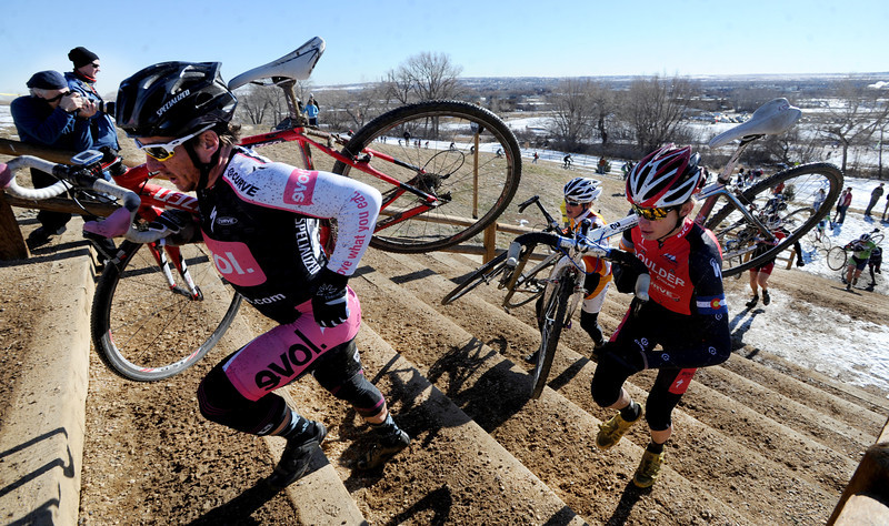 "Grant Holicky, left, and Nevin Whittemore,  run up the stairs with their bikes during the ""A"" race of the 2012 New Years CX Race at Valmont Bike Park in Boulder on Saturday.<br /> For more photos and a video from the race, go to  <a href=""http://www.dailycamera.com"">http://www.dailycamera.com</a>.<br /> Cliff Grassmick  / January 5, 2013"