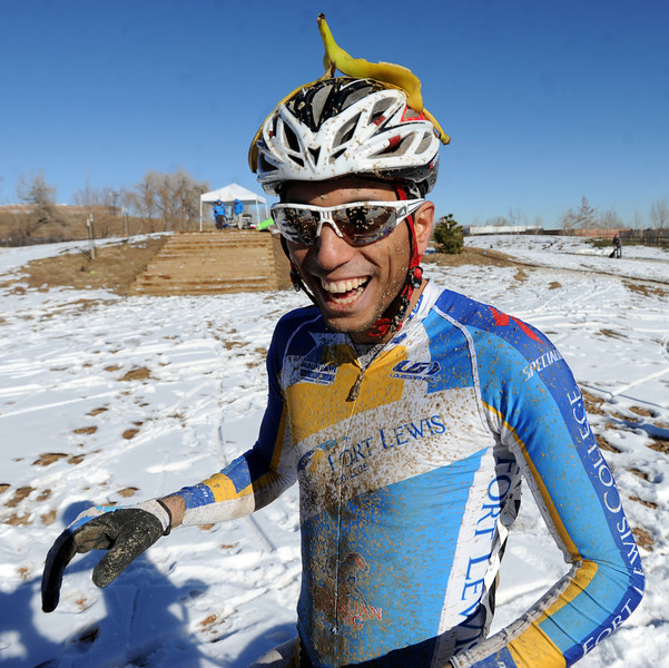"Rotem Ishay, from Ft Lewis College, gets a banana from his friends after winning the ""A"" race of the 2012 New Years CX Race at Valmont Bike Park in Boulder on Saturday.<br /> For more photos and a video from the race, go to  <a href=""http://www.dailycamera.com"">http://www.dailycamera.com</a>.<br /> Cliff Grassmick  / January 5, 2013"