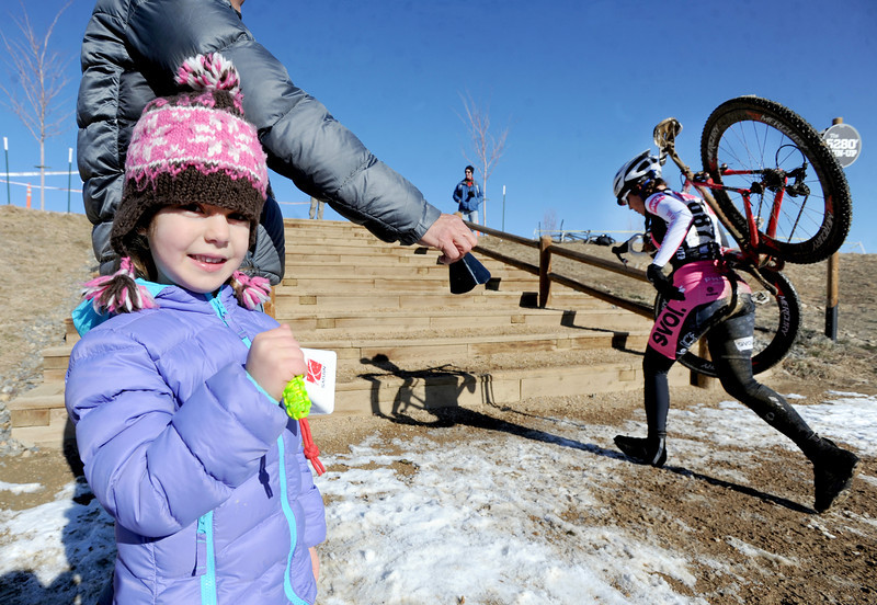 "Eliana Alper, 5, and her dad, David, ring cow bells to encourage racers in the ""B"" race of the 2012 New Years CX Race at Valmont Bike Park in Boulder on Saturday.<br /> For more photos and a video from the race, go to  <a href=""http://www.dailycamera.com"">http://www.dailycamera.com</a>.<br /> Cliff Grassmick  / January 5, 2013"