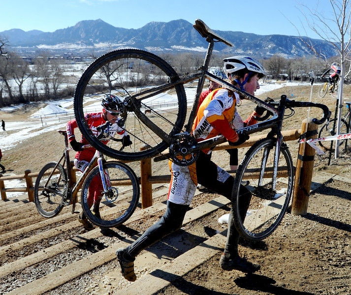 "Racer Gage Hecht, 15,  runs up the stairs with his bike during the ""A"" race of the 2012 New Years CX Race at Valmont Bike Park in Boulder on Saturday.<br /> For more photos and a video from the race, go to  <a href=""http://www.dailycamera.com"">http://www.dailycamera.com</a>.<br /> Cliff Grassmick  / January 5, 2013"