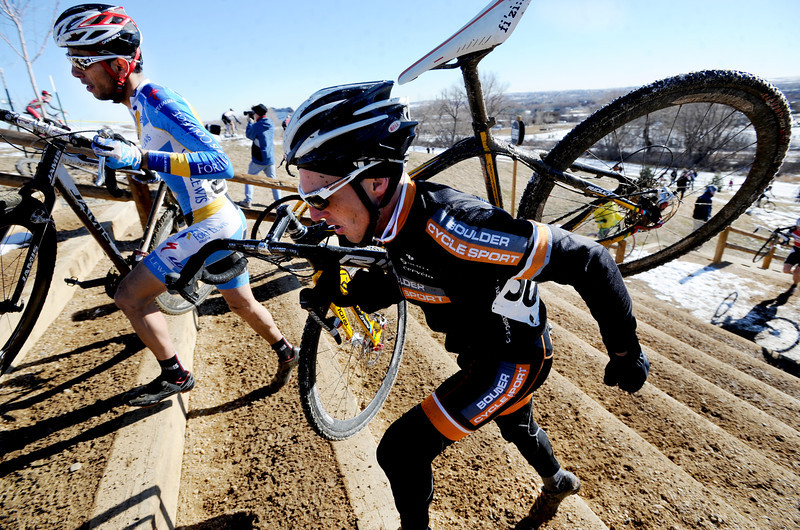 "Winner, Rotem Ishay, left, and  Brian Hludzinski,  run up the stairs with their bikes during the ""A"" race of the 2012 New Years CX Race at Valmont Bike Park in Boulder on Saturday.<br /> For more photos and a video from the race, go to  <a href=""http://www.dailycamera.com"">http://www.dailycamera.com</a>.<br /> Cliff Grassmick  / January 5, 2013"