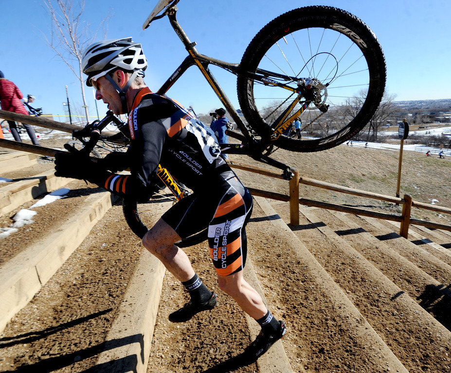 "Racer Peter Webber,  runs up the stairs with his bike during the ""A"" race of the 2012 New Years CX Race at Valmont Bike Park in Boulder on Saturday.<br /> For more photos and a video from the race, go to  <a href=""http://www.dailycamera.com"">http://www.dailycamera.com</a>.<br /> Cliff Grassmick  / January 5, 2013"