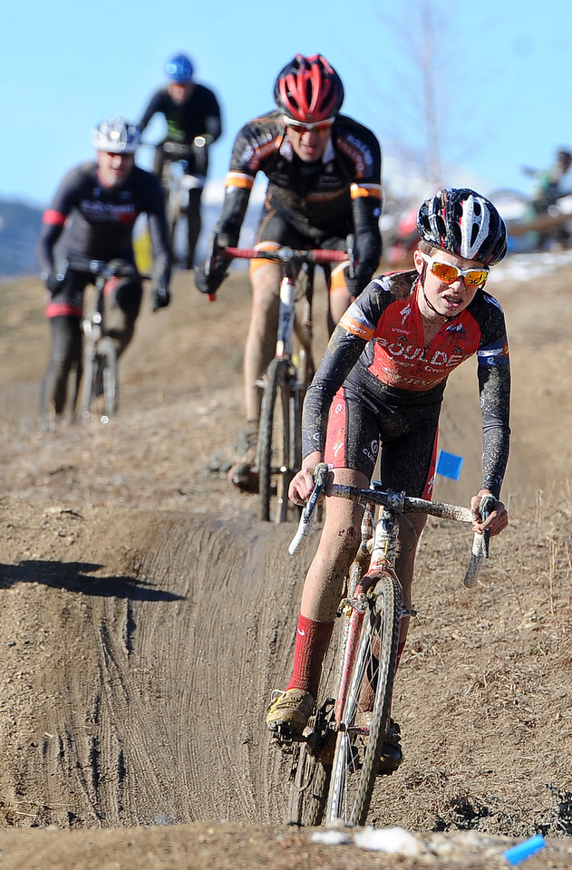 "Racer Eric Brunner, 14,  leads a group riding hills during the ""A"" race of the 2012 New Years CX Race at Valmont Bike Park in Boulder on Saturday.<br /> For more photos and a video from the race, go to  <a href=""http://www.dailycamera.com"">http://www.dailycamera.com</a>.<br /> Cliff Grassmick  / January 5, 2013"