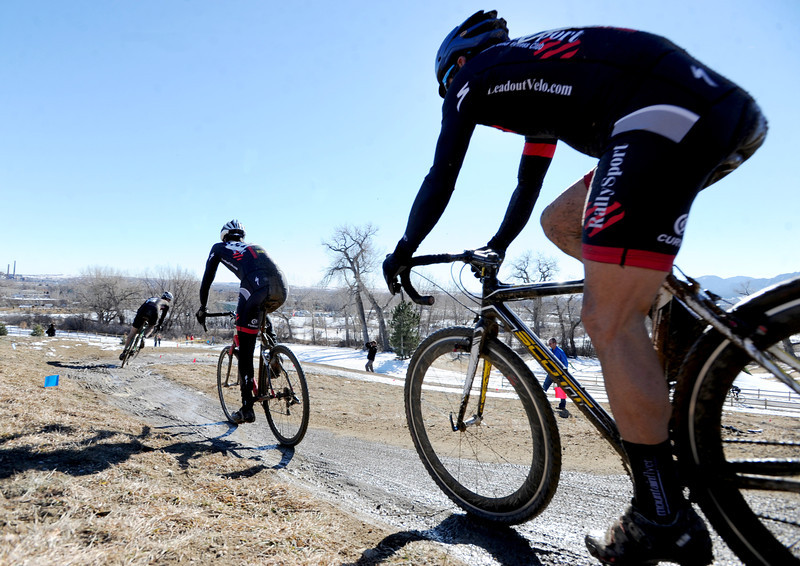 """Racer Shawn Lortie, right, follows riders around turns during the """"A"""" race of the 2012 New Years CX Race at Valmont Bike Park in Boulder on Saturday.<br /> For more photos and a video from the race, go to  <a href=""""http://www.dailycamera.com"""">http://www.dailycamera.com</a>.<br /> Cliff Grassmick  / January 5, 2013"""