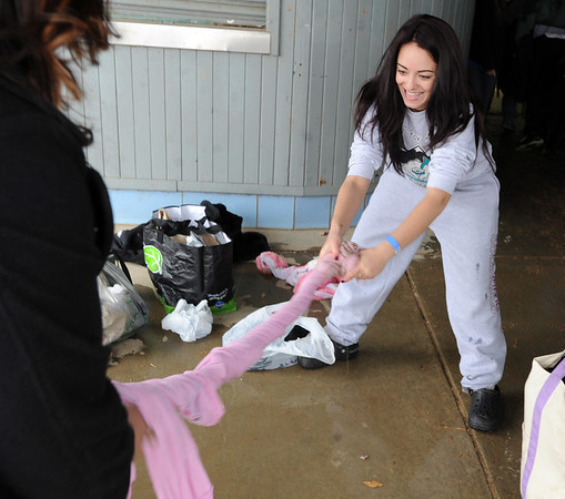 "Jessica Boisseaux, right, rings the water from her pajamas that were used to make the plunge.<br /> The Polar Plunge is a grassroots fundraiser presented by the Law Enforcement Torch Run for Special Olympics Colorado.<br /> For more photos and a video, go to  <a href=""http://www.dailycamera.com"">http://www.dailycamera.com</a>.<br />  Cliff Grassmick  / February 9, 2013"