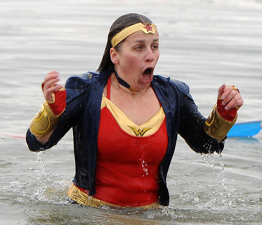 "Kristin Miller isn't sure if Wonder Woman can deal with the cold water on Saturday.<br /> The Polar Plunge is a grassroots fundraiser presented by the Law Enforcement Torch Run for Special Olympics Colorado.<br /> For more photos and a video, go to  <a href=""http://www.dailycamera.com"">http://www.dailycamera.com</a>.<br />  Cliff Grassmick  / February 9, 2013"