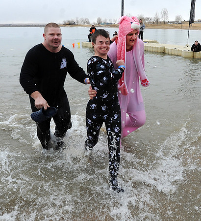 "Vern Earwood, left, Hayden  Boisseaux, and Jimmy Dennis, quickly exit the water after their polar plunge on Saturday.<br /> The Polar Plunge is a grassroots fundraiser presented by the Law Enforcement Torch Run for Special Olympics Colorado.<br /> For more photos and a video, go to  <a href=""http://www.dailycamera.com"">http://www.dailycamera.com</a>.<br />  Cliff Grassmick  / February 9, 2013"