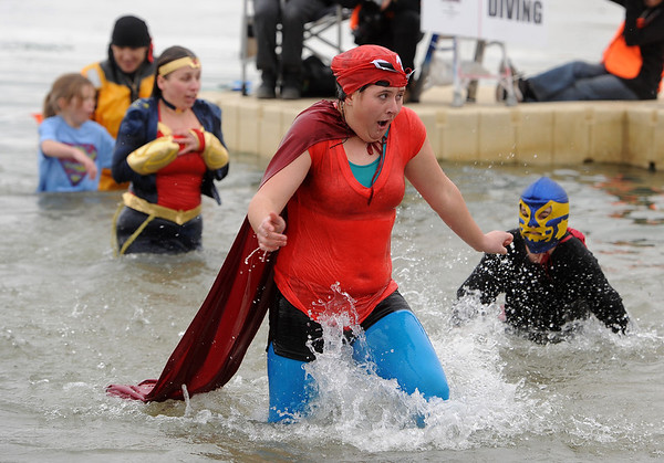 "Kaitlyn Smith, center, is feeling the cold of Boulder Reservoir as she exits with her team.<br /> The Polar Plunge is a grassroots fundraiser presented by the Law Enforcement Torch Run for Special Olympics Colorado.<br /> For more photos and a video, go to  <a href=""http://www.dailycamera.com"">http://www.dailycamera.com</a>.<br />  Cliff Grassmick  / February 9, 2013"