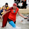 "Kaitlyn Smith is feeling the cold of Boulder Reservoir as she exits with her team.<br /> The Polar Plunge is a grassroots fundraiser presented by the Law Enforcement Torch Run for Special Olympics Colorado.<br /> For more photos and a video, go to  <a href=""http://www.dailycamera.com"">http://www.dailycamera.com</a>.<br />  Cliff Grassmick  / February 9, 2013"