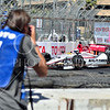 Photographer taking a photo at the 2013 Toyota Grand Prix of Long Beach FYI: All purchased downloads or prints will not have the watermark.