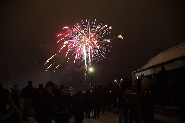 The crowd gathers at Long Wharf to watch fireworks on New Year's 2013