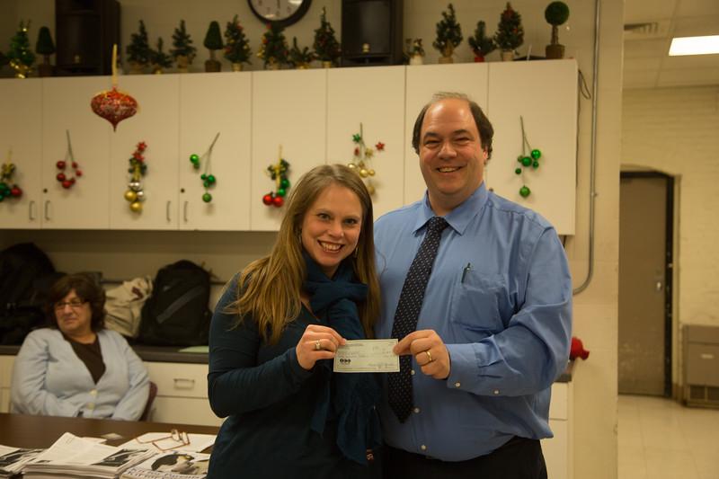 NEMPAC Executive Director Rebecca Griffin accepts a contribution from NEAD President, John Romano