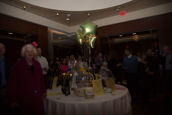 Photographer Michele Morgan on the left as the crowd surrounds the raffle basket table