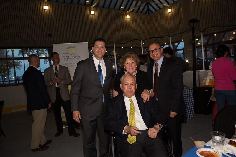 Mayor Thomas Menino (sitting) with State Senator Anthony Pettruccelli (left), Angela Menino and City Councilor Sal LaMattina (right)