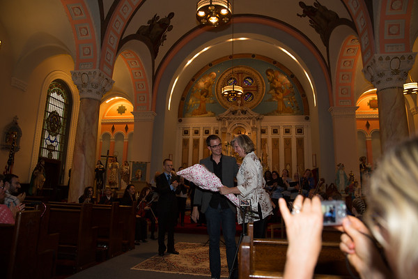 """Christopher Gainey, Composer of """"Dona Nobis Pacem"""" for St. Leonard Choral Society, at debut performance presenting flowers to his Mom on Mother's Day"""