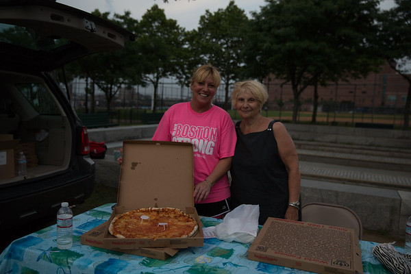 Karen and Lillian serve donated Regina's Pizza at the North2South Game - 2013-06-24 at 19-09-58
