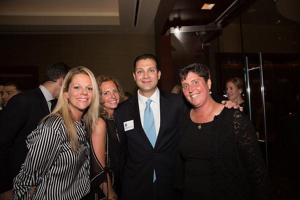 (L-R) Alessandra Petruccelli, Katie Everett, State Senator Anthony Petruccelli and Eliot School Principal Traci Walker Griffith
