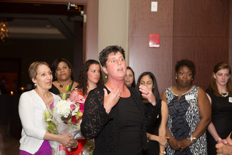 Eliot School Principal Traci Walker Griffith Speaks at the Spring Fling Surrounded by Teachers and Staff