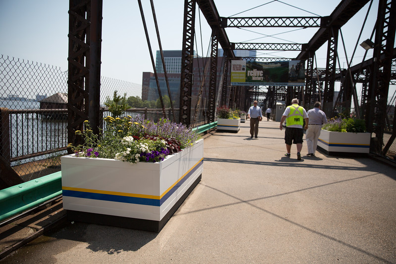 Planters line the sides of the pedestrian walkway on the Old Northern Avenue Bridge