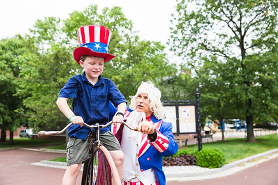 Jack gets a lift on a bicycle from Uncle Sam