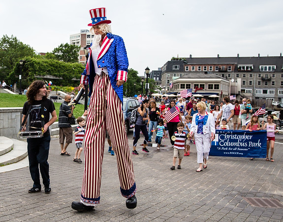 Uncle Sam on Stilts leads the parade in the park