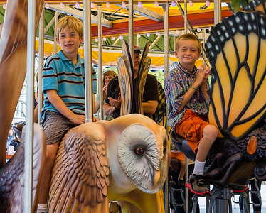 Children enjoy the local custom characters on the Greenway Carousel's first rides