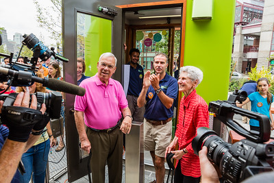 Pushing the Opening Day Button - Mayor Thomas M. Menino (left) and Ms. Amalie Kass, lead donor for the Greenway Carousel (right)