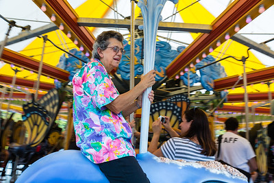 Folks of all ages enjoy the first rides on the custom carousel