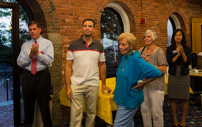 Mayoral candidate Marty Walsh (left), State Sen. Anthony Pettrucelli (center) and City Councilor at Large candidate Michelle Wu (right) with residents at NEWRA's summer party