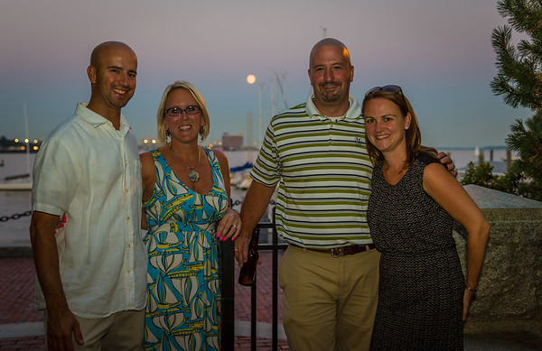 Residents enjoy the full moon on the Pilot House patio at NEWRA's summer party
