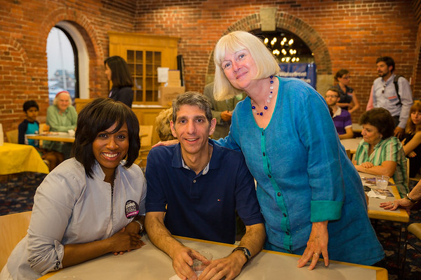 City Councilor Ayanna Pressley (left) with residents Michael Giardiello and Mary McGee