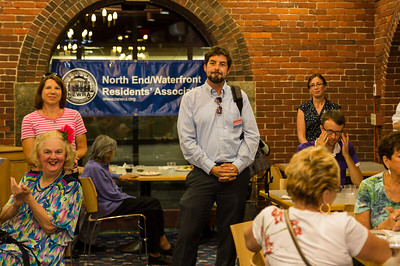 District 1 City Councilor candidate Brian Gannon with residents at NEWRA summer party